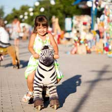 ZOO-RDING Child on Zebra